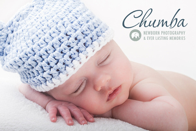 Newborn baby photography showing a baby laying on his hand